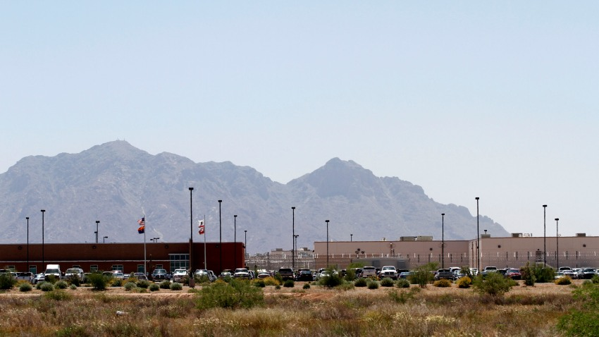 Vehicles are parked outside the La Palma Correctional Center in Eloy, Arizona