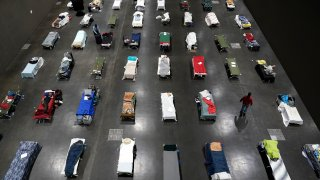 Beds fill the San Diego Convention Center for the homeless