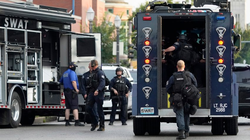 Police work near the scene of a shooting Saturday, Aug. 29, 2020, in St. Louis.