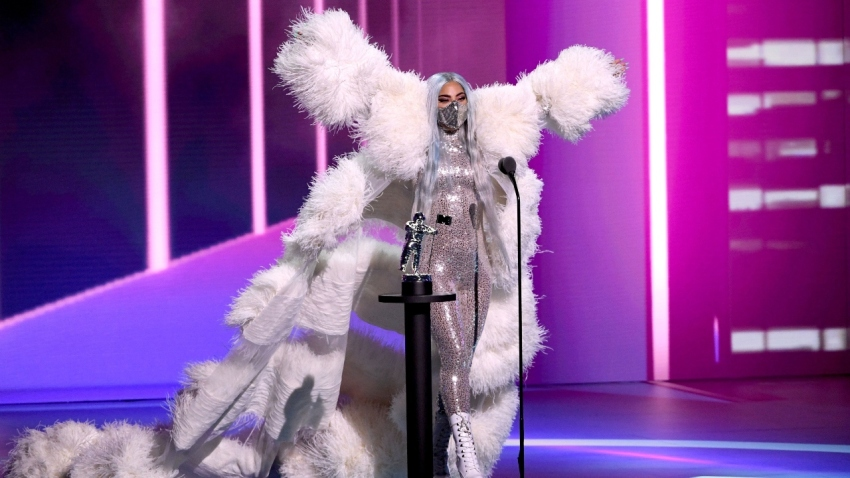 Lady Gaga accepts the Artist of the Year award onstage