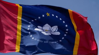 In this Sept. 2, 2020, file photo, the magnolia centered banner chosen by the Mississippi State Flag Commission flies outside the Old State Capitol Museum in downtown Jackson, Mississippi.