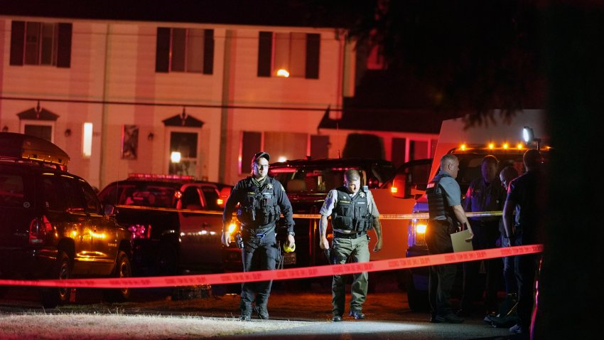 Police officials work at a scene