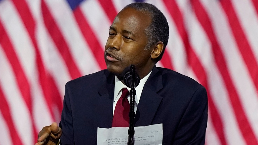 Secretary of Housing and Urban Development Ben Carson holds notes as he speaks during a campaign event before President Donald Trump at the Cobb Galleria Centre, Friday, Sept. 25, 2020, in Atlanta.