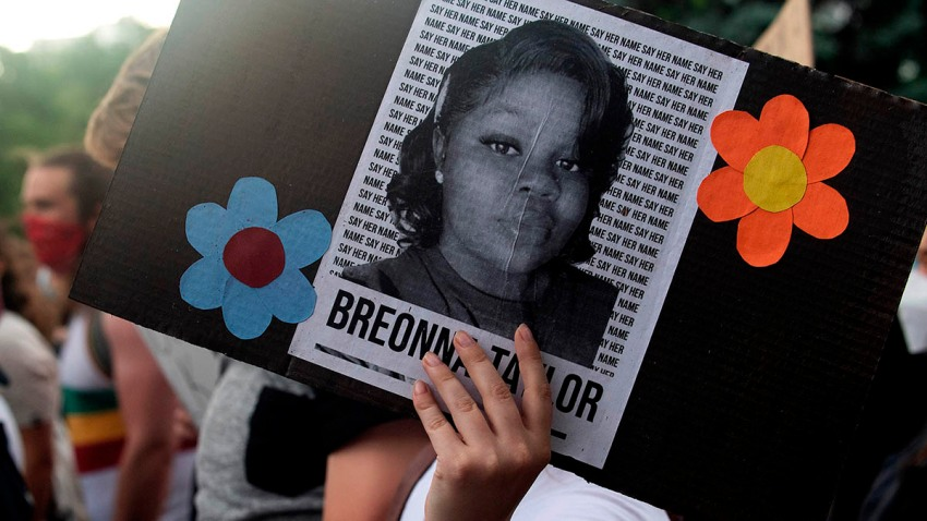 A demonstrator in Denver, Colorado, holds a sign with the image of Breonna Taylor, a Black woman who was fatally shot by Louisville Metro Police Department officers, during a protest against police brutality, June 3, 2020.
