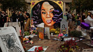 In this Sept. 26, 2020, file photo, people gather at a memorial for Breonna Taylor in downtown Louisville, Kentucky.