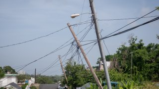 Light poles listing to the side since Hurricane Maria touched land, on September 19, 2018, in Luquillo, Puerto Rico.