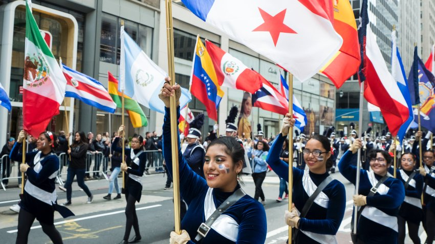Participants march down 5th Avenue with flags of various Hispanic countries during the 55th Hispanic Day Parade