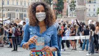 In this June 7, 2020, file photo, Stella Jean, the first Italian Black designer, is seen at the Black Lives Matter protest in Piazza del Popolo in Italy.