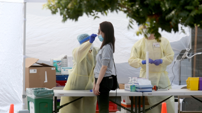 OAKLAND, CA - SEPTEMBER 15: A woman gets tested at a Covid-19 test site at Madison Park in downtown Oakland, Calif., on Tuesday, Sept. 15, 2020. Asian Health Services has partnered with Alameda County to manage the site, which offers services in 12 languages.