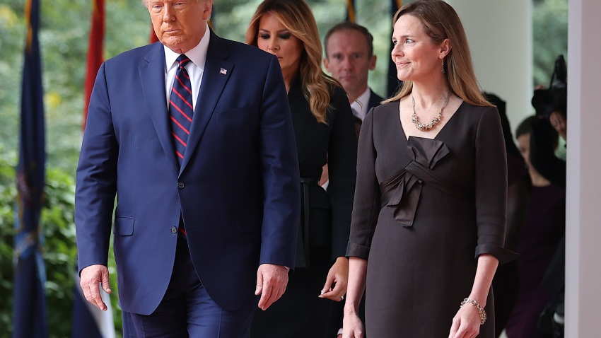 President Donald Trump (L) arrives to introduce 7th U.S. Circuit Court Judge Amy Coney Barrett as his nominee to the Supreme Court in the Rose Garden at the White House Sept. 26, 2020, in Washington. With 38 days until the election, Trump tapped Barrett to be his third Supreme Court nominee in just four years and to replace the late Associate Justice Ruth Bader Ginsburg, who will be buried at Arlington National Cemetery on Tuesday.