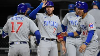 Cubs players congratulate Kris Bryant after he hits a grand slam against the White Sox
