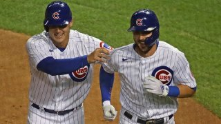 Anthony Rizzo and Kris Bryant celebrate scoring against the Cardinals on September 4th.