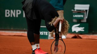 Serena Williams of the U.S. reacts after missing a shot against Kristie Ahn of the U.S. in the first round match of the French Open tennis tournament at the Roland Garros stadium in Paris, France, Monday, Sept. 28, 2020.