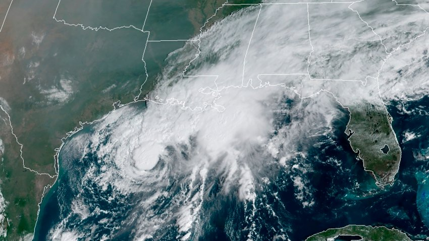 This GOES-16 GeoColor satellite image taken Saturday, Sept. 19, 2020, and provided by NOAA, shows Tropical Storm Beta, center, in the Gulf of Mexico.