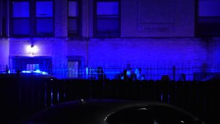 Chicago police investigate the scene of a shooting where two people were killed and at least four others were hurt Saturday.