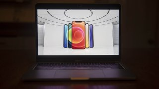 The Apple iPhone 12 is unveiled during a virtual product launch seen on a laptop computer in Tiskilwa, Illinois, Oct. 13, 2020. Apple Inc. revealed four redesigned iPhones with 5G wireless capability, upgraded cameras, faster processors and a wider range of screen sizes.