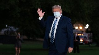 President Donald Trump waves as he returns to the White House Monday, Oct. 5, 2020, in Washington, after leaving Walter Reed National Military Medical Center, in Bethesda, Md. Trump announced he tested positive for COVID-19 on Oct. 2.