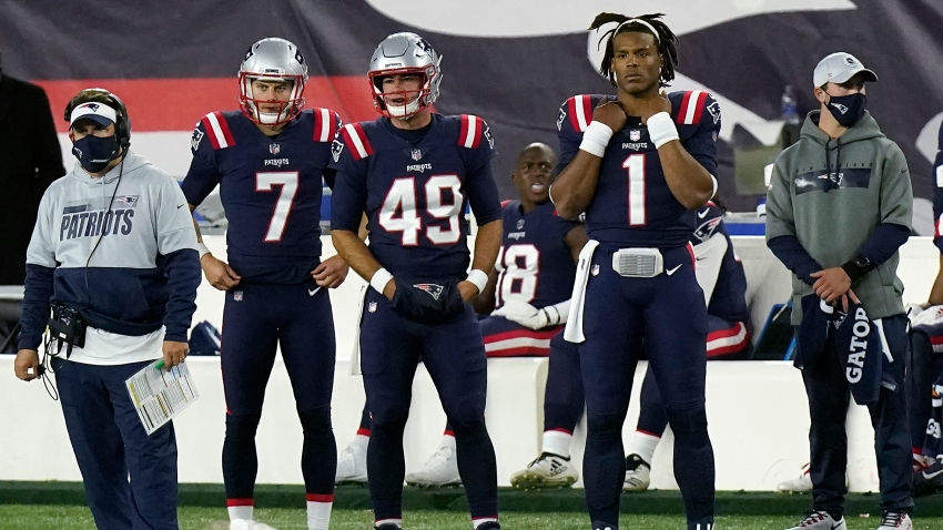 New England Patriots quarterback Cam Newton (1) watches from the sideline after being replaced by Jarrett Stidham in the second half of an NFL football game against the San Francisco 49ers, Sunday, Oct. 25, 2020, in Foxborough, Mass.