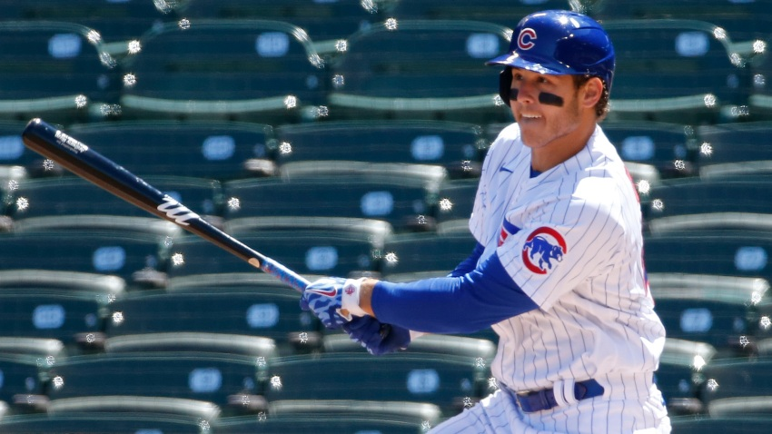 Anthony Rizzo watches a double off his bat in a Cubs game vs the Cardinals