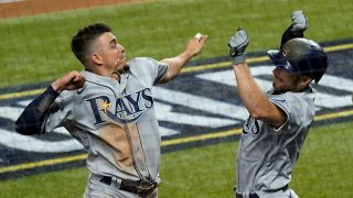 Tampa Bay Rays' Brandon Lowe, right, celebrates his a two-run home run with Willy Adames against the Los Angeles Dodgers during the fifth inning in Game 2 of the baseball World Series Wednesday, Oct. 21, 2020, in Arlington, Texas.