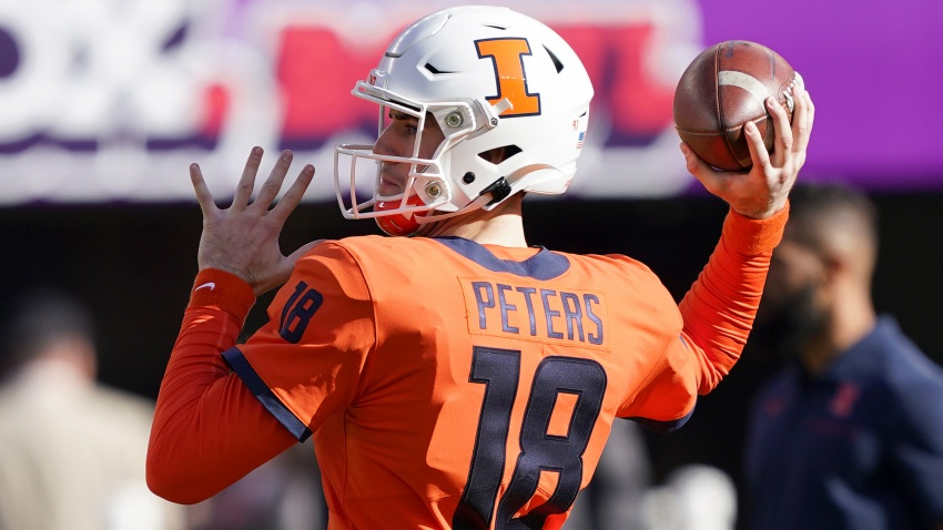 Quarterback Brandon Peters #18 of the Illinois Fighting Illini warms up prior to the start of the RedBox Bowl game against the California Golden Bears at Levi's Stadium