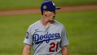 Los Angeles Dodgers starting pitcher Walker Buehler celebrates the end of the third inning against the Tampa Bay Rays in Game 3 of the baseball World Series Friday, Oct. 23, 2020, in Arlington, Texas.