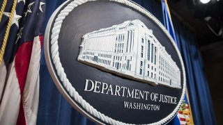 In this Aug. 4, 2017, file photo, the Department of Justice logo is seen in Washington, D.C.