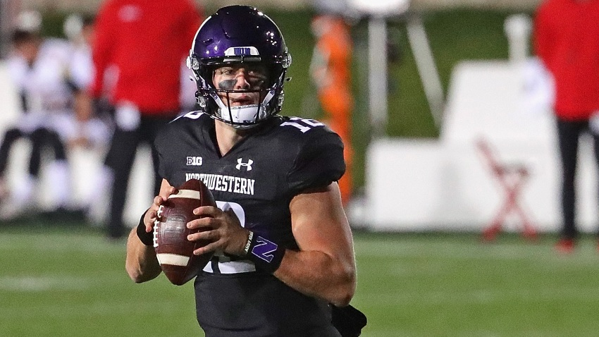 Peyton Ramsey #12 of the Northwestern Wildcats looks for a receiver against the Maryland Terrapins at Ryan Field on October 24, 2020 in Evanston, Illinois