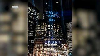 biden-harris campaign logo shines on Trump Tower in Chicago