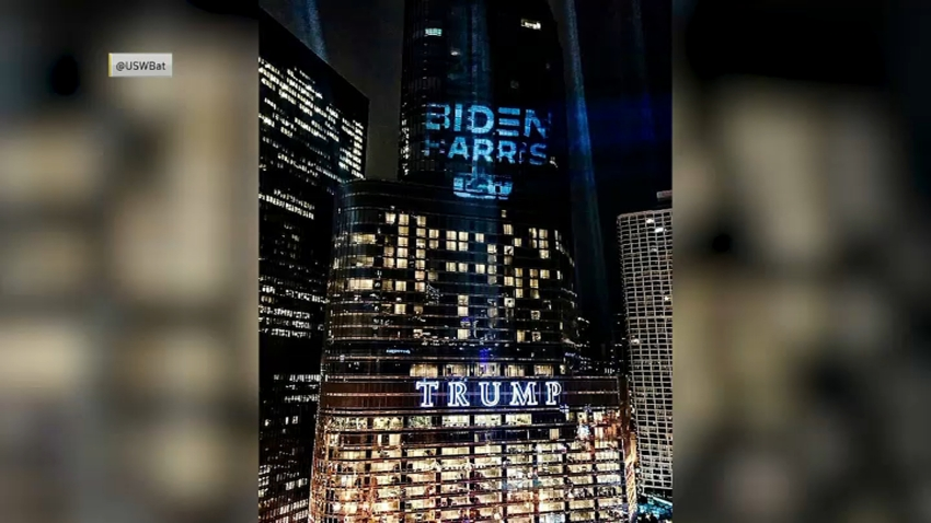 biden-harris campaign logo shines on Trump Tower in Chicago
