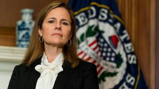 In this Oct. 1, 2020, file photo, Seventh U.S. Circuit Court Judge Amy Coney Barrett, President Donald Trump's nominee for the U.S. Supreme Court, meets with Sen. Jerry Moran (R-Kan.) as she prepares for her confirmation hearing, on Capitol Hill in Washington, D.C.
