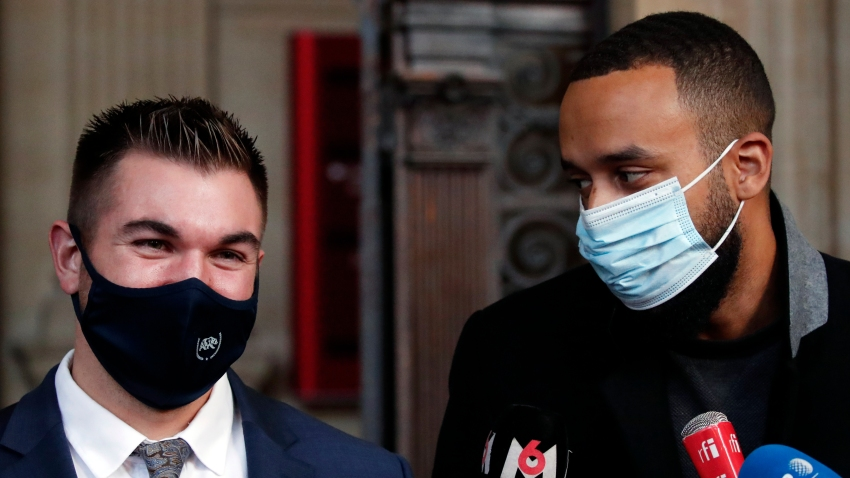 Alek Skarlatos, left, and Anthony Sadler, right, deliver a speech during the Thalys attack trial at the Paris courthouse, Friday, Nov. 20, 2020. Passengers who wrestled and disarmed an Islamic State gunman aboard a high-speed Amsterdam to Paris train are recounting how their split-second decisions helped prevent what could have become a mass slaughter.