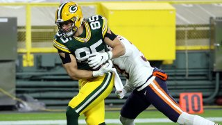 Robert Tonyan #85 of the Green Bay Packers catches a pass for a touchdown as Eddie Jackson #39 of the Chicago Bears defends during the 2nd half of the game at Lambeau Field on November 29, 2020 in Green Bay, Wisconsin.