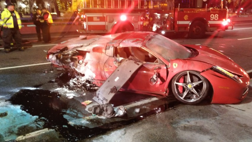 A Ferrari sports car flipped over on Lake Shore Drive November 28 and caught fire, police said