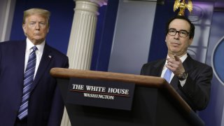 U.S. President Donald Trump, left, listens as Steven Mnuchin, U.S. Treasury secretary speaks during a news conference at the White House in Washington D.C., U.S. on Tuesday, April 21, 2020. TheTrumpadministration vowed to stem job losses and rescue the oil industry with stimulus funds and other measures as theU.S.responds to a global glut in crude thats led to an historic rout in prices.