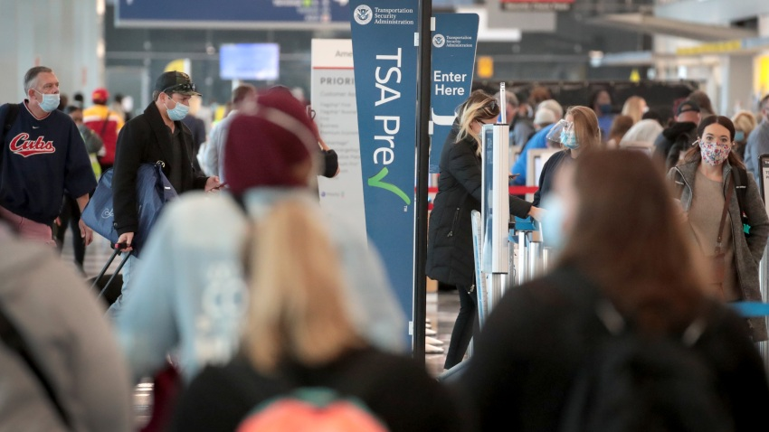 Passengers enter a Transportation Security Administration (TSA) checkpoint at O'Hare International Airport