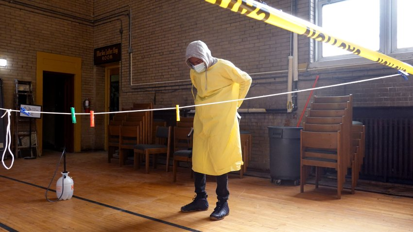 A workers gets prepared to help residents perform COVID-19 tests at a test site run by CORE at St. Benedict the African Catholic Church in the Englewood neighborhood