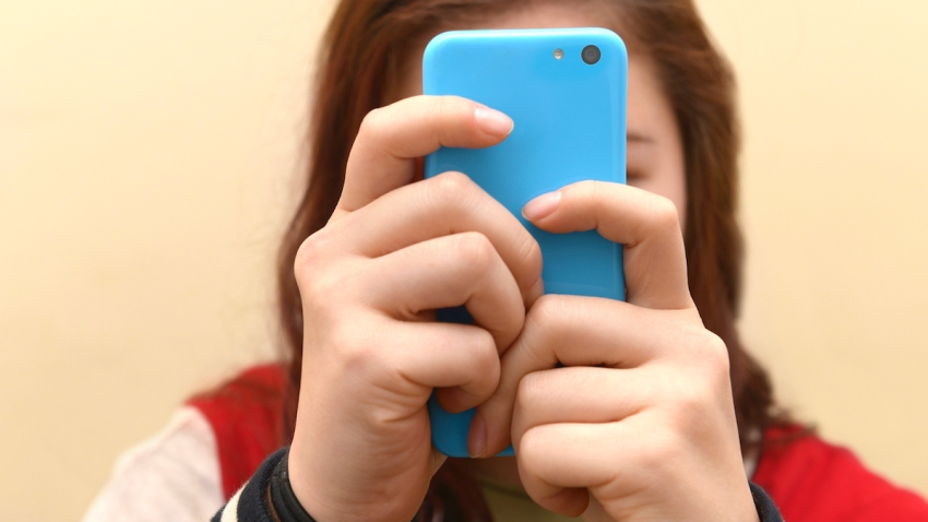 Close up of a teenager on her smartphone
