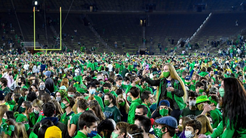 Fans storm the field after Notre Dame defeated the Clemson 47-40 in two overtimes in an NCAA college football game Saturday, Nov. 7, 2020, in South Bend, Indiana.