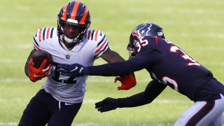 Chicago Bears wide receiver Anthony Miller tries to make his way around a Houston Texans defender in a Bears win at Soldier Field