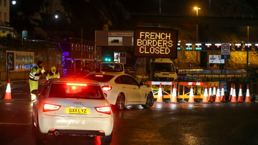 Police and port staff turn away vehicles from the Port of Dover in Kent, England which has been closed after the French government's announcement, Monday, Dec. 21, 2020. France banned all travel from the United Kingdom for 48 hours from midnight Sunday, including trucks carrying freight through the tunnel under the English Channel or from the port of Dover on England's south coast.