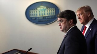 WASHINGTON, DC - MARCH 18: U.S. Secretary of Veterans Affairs Robert Wilkie speaks as President Donald Trump listens during a news briefing on the latest development of the coronavirus outbreak in the U.S. at the James Brady Press Briefing Room at the White House March 18, 2020 in Washington, DC. President Trump announced on Twitter that the U.S. and Canada will close their border to non-essential traffic to try and stop the spread of the COVID-19 pandemic.