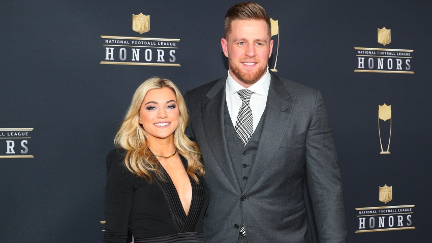 Texans star JJ Watt, wearing a gray suit, and his wife Kealia Watt, wearing a black dress, appear prior to the NFL Honors ceremony in 2020