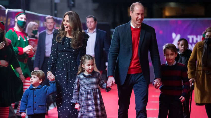 Prince William, Duke of Cambridge, and Catherine, Duchess of Cambridge, with their children, Prince Louis, Princess Charlotte and Prince George, attend a special pantomime performance at London's Palladium Theatre, hosted by The National Lottery, to thank key workers and their families for their efforts throughout the pandemic on December 11, 2020, in London, England.
