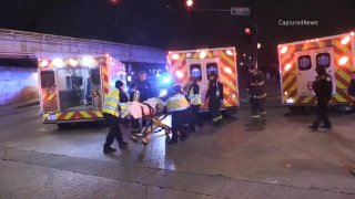 Multiple ambulances on the scene after a vehicle crashed into a Chicago ambulance on December 6th, with a patient being transported on a stretcher