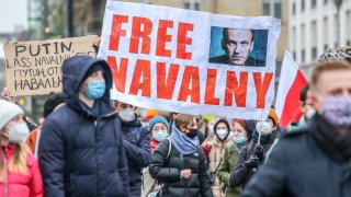 """In this Jan. 23, 2021, file photo, protesters hold a banner reading """"FREE NAVALNY"""" as some 2,500 supporters of Russian opposition politician Alexei Navalny march in protest to demand his release from prison in Moscow in Berlin, Germany."""