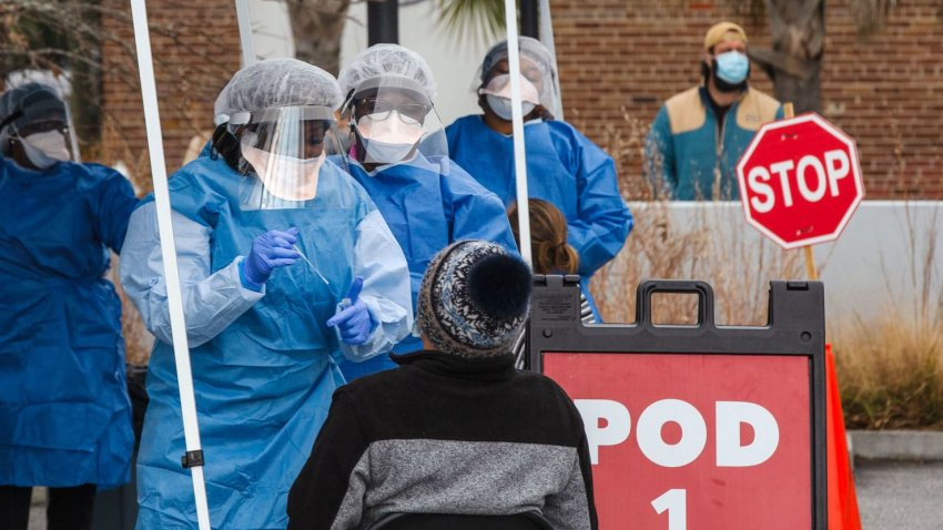 In this Jan. 13, 2021, file photo, healthcare workers from the Medical University of South Carolina administer free COVID-19 tests at a site in a parking lot between Edmund's Oast and Butcher & Bee restaurants in Charleston, South Carolina.