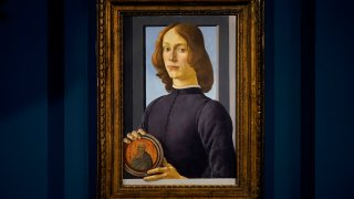 """Sandro Botticelli's """"Young Man Holding a Roundel"""" is displayed at Sotheby's in New York"""