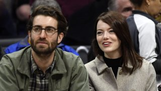 Emma Stone and Dave McCary attend the Golden State Warriors and Los Angeles Clippers basketball game at Staples Center on January 18, 2019 in Los Angeles, California.