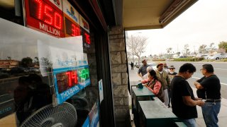 A line forms to buy lottery tickets.